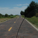A little piece of history from 1932. An original brick road just North of Auburn, IL. It is a bare 1.5 mile long very well preserved old section of R66. As you notice it must be the beginning of the journey as not many dead flies decorate my windshield. By the way, the road is surprisingly insect free all way long.